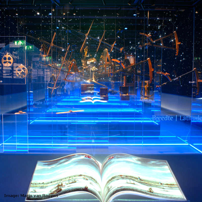 An open book with ships in it at the exhibition in the National Maritime Museum in Amsterdam.