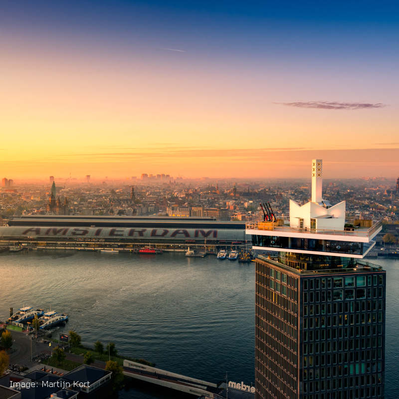 Aerial view of Amsterdam and the A'dam Lookout tower at sundown.