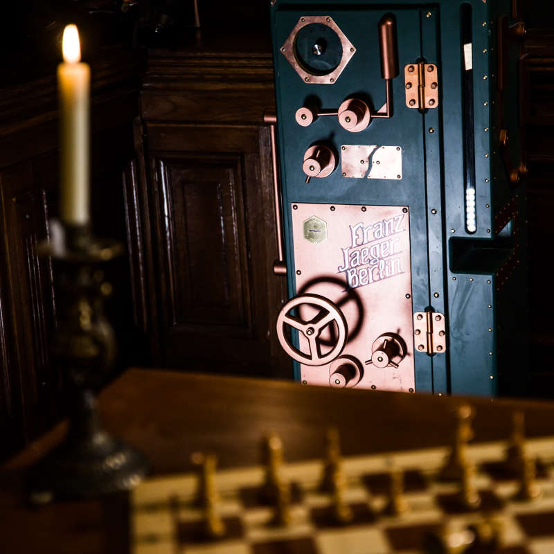 A candle, a chess game and a safe in escape room The Society in Amsterdam.