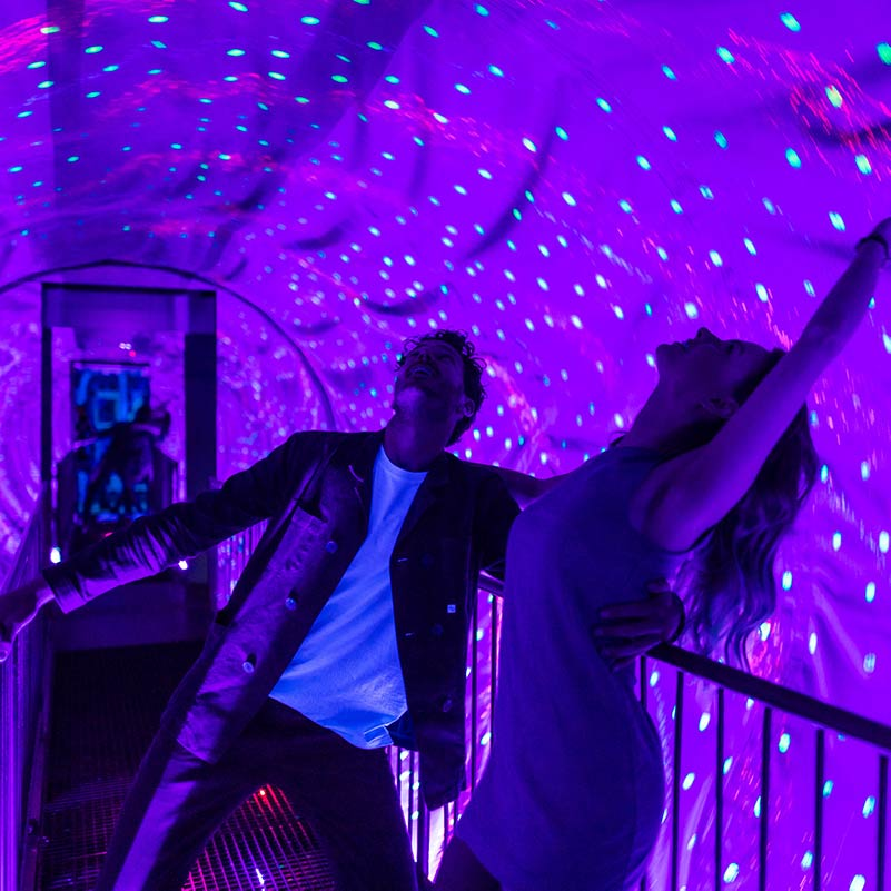 Two people dancing in the space tunnel at Ripley's Believe it or not Amsterdam.
