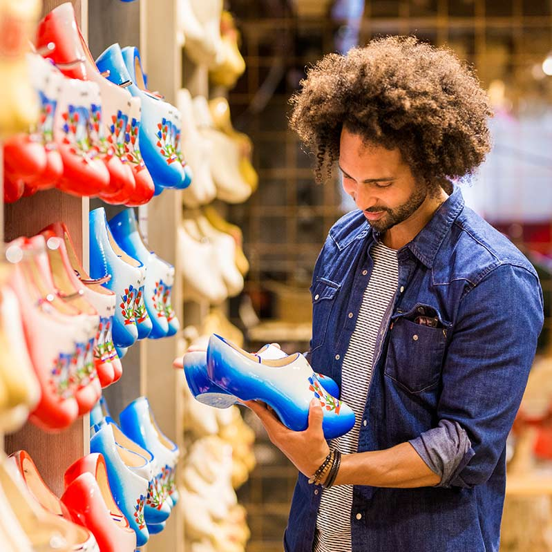 Man looking at Dutch clogs in Marken.
