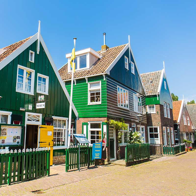 Traditional Dutch wooden houses in a Dutch Countryside village.