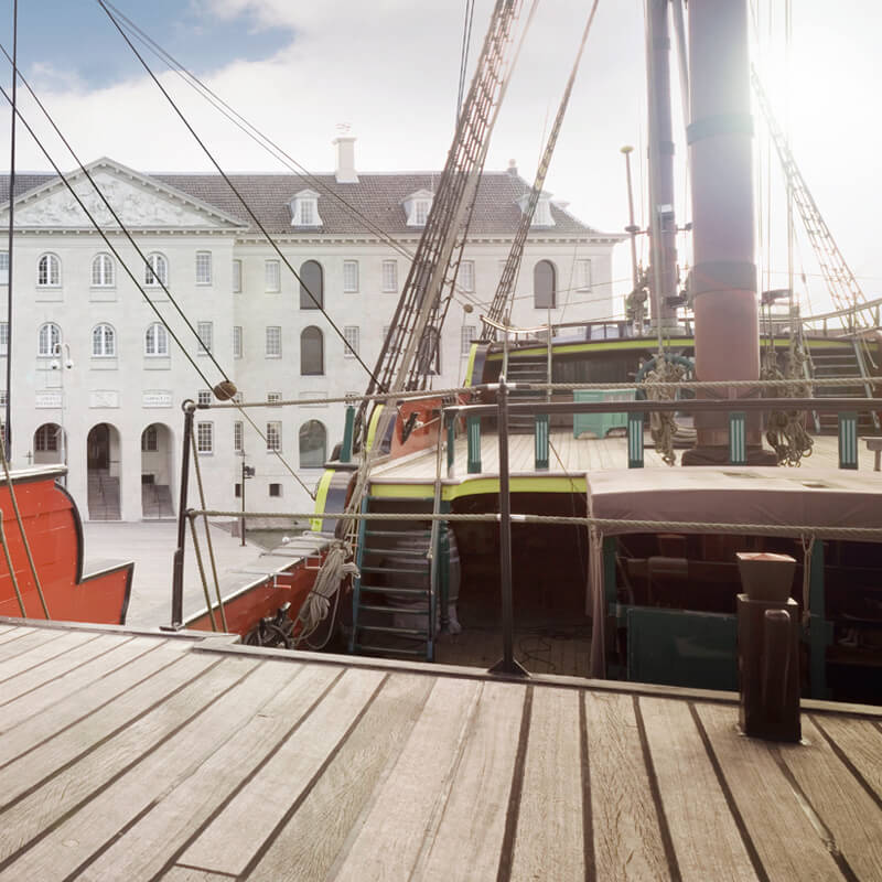 Photo taken from a replica of a VOC ship with a view of the Maritime museum in Amsterdam.