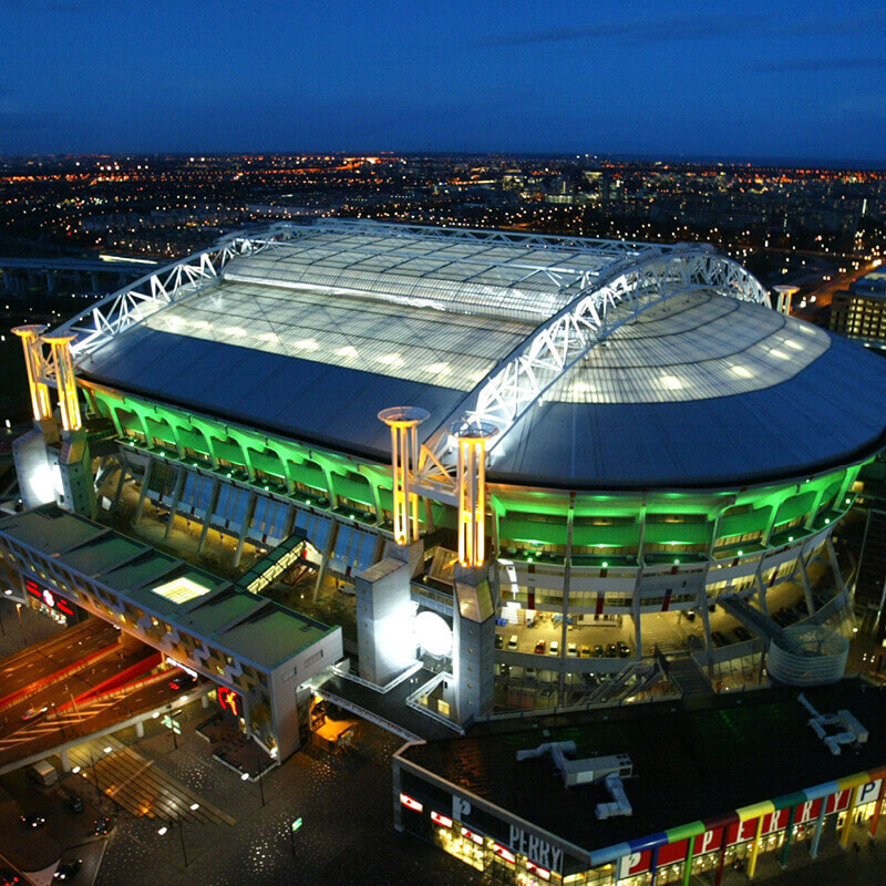 Aerial view of the Johan Cruijff Amsterdam ARENA at night.